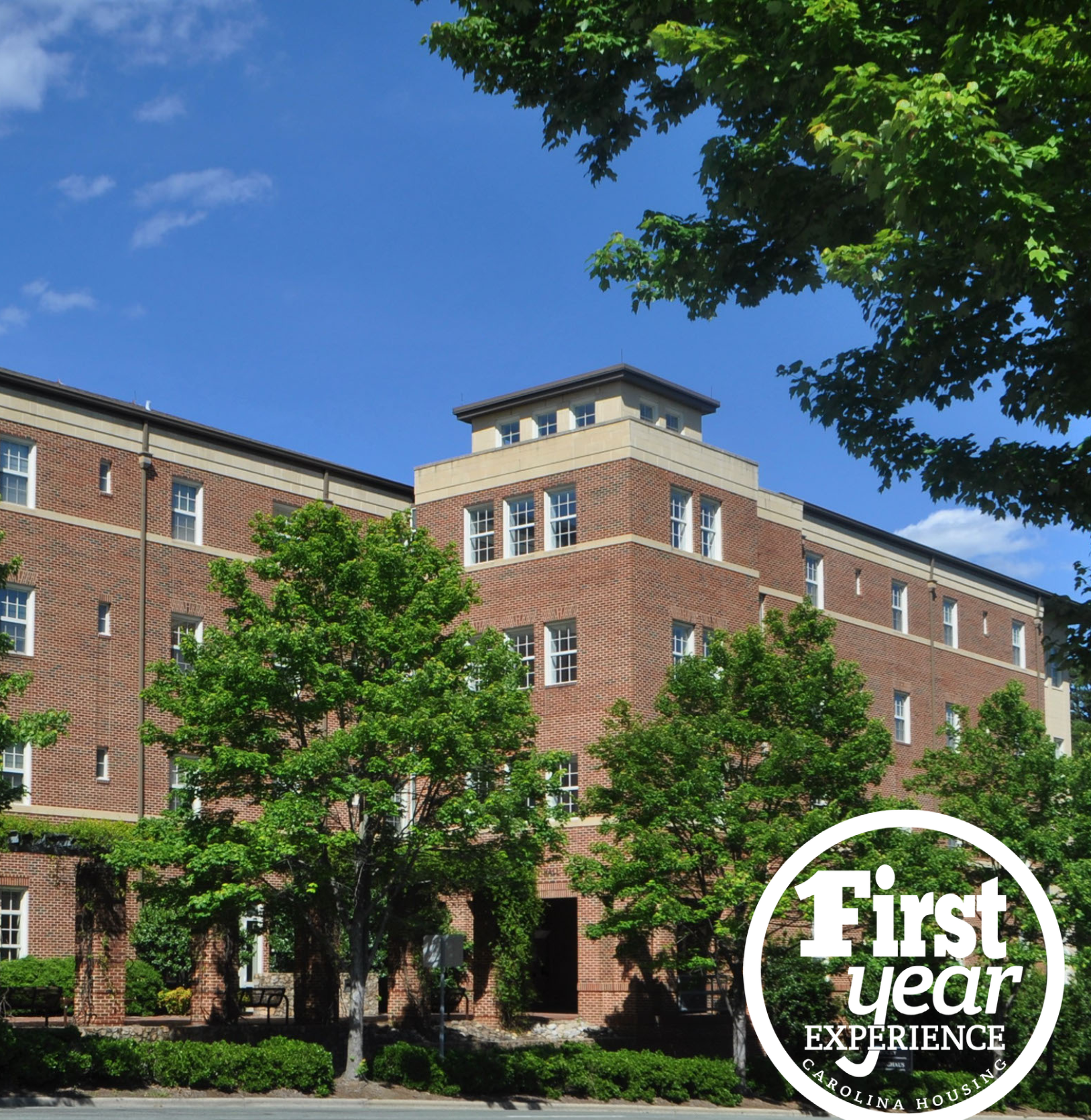 Koury residence hall with the First Year Experience logo in the right corner.