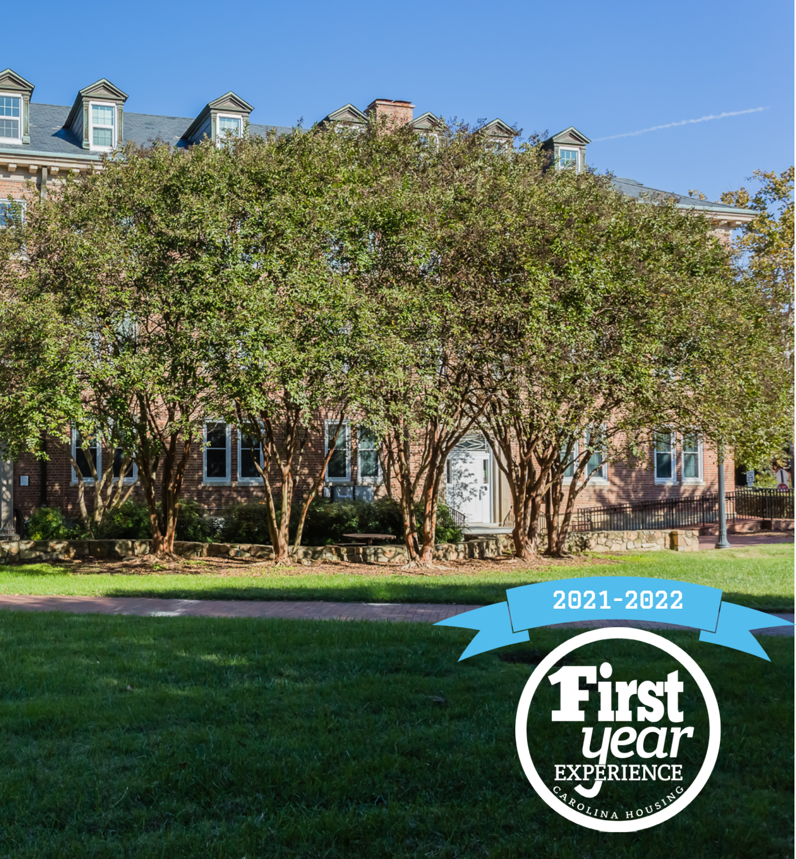 Mangum residence hall with the First Year Experience logo in the right corner.